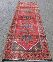 RED GROUND PERSIAN RUNNER WITH CROSS MEDALLION DESIGN 323 X 110CM Condition Report: