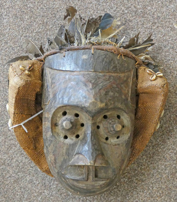 CARVED TRIBAL MASK WITH RAISED EYES,