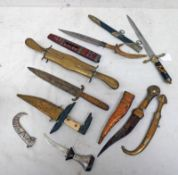 MIDDLE EASTERN DAGGERS AND KNIFES TO INCLUDE A INTERESTING DOUBLE EDGED DAGGER WITH RAISED MEDIAL