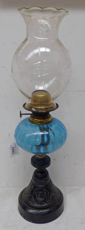 PARAFFIN LAMP WITH BLUE GLASS RESERVOIR ON A CAST METAL BASE