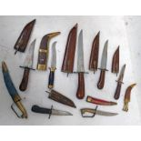 SELECTION OF TRIBAL STYLE KNIFES SOME WITH DECORATION TO BLADES