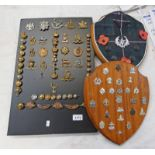 SELECTION OF CAP BADGES AND BUTTONS MOUNTED ON 3 PLINTHS TO INCLUDE,