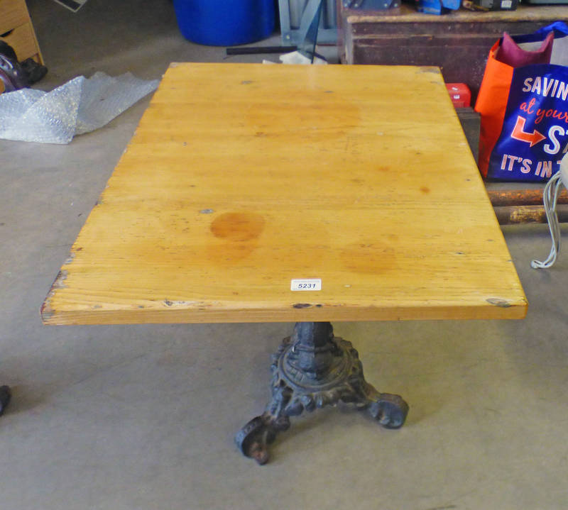 PINE TOPPED TABLE WITH CAST IRON BASE