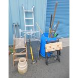 VARIETY OF GARDEN TOOLS INCLUDING RAKE, SHOVELS, PITCH FORK, ROUGHNECK AXE, WOODEN STEP LADDER,