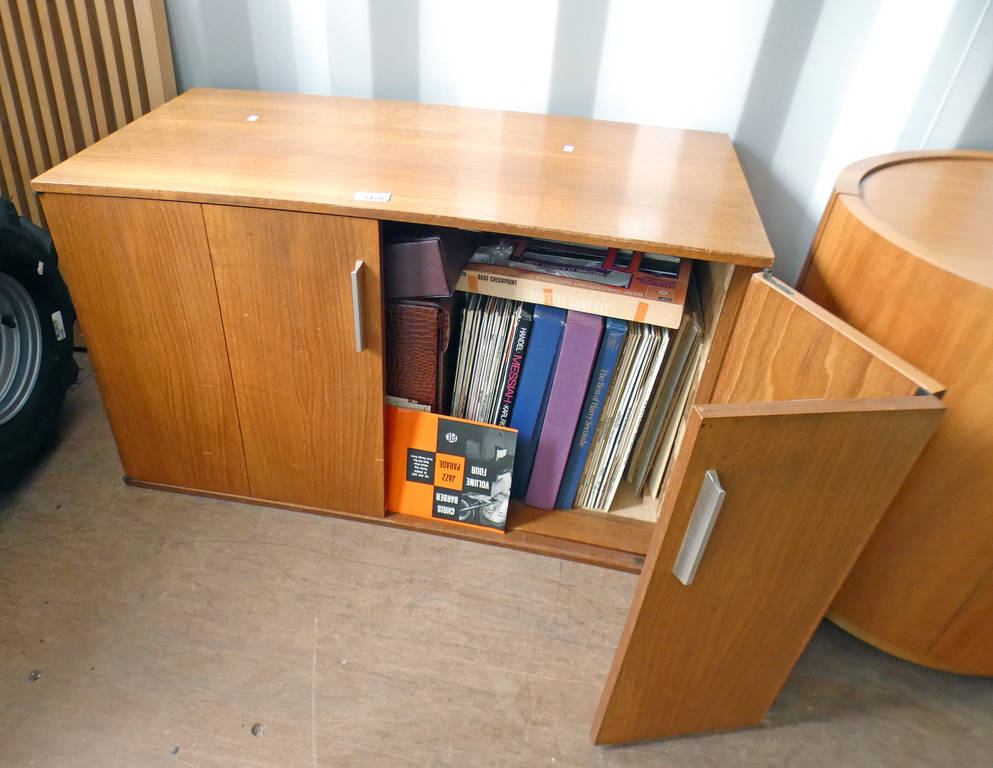 TEAK CABINET WITH 2 FOLDING DOORS OPENING TO LARGE SELECTION OF RECORDS, ETC,