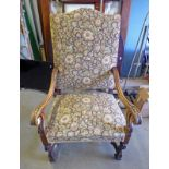 19TH CENTURY MAHOGANY FRAMED ARMCHAIR WITH SHAPED ARMS & SHAPED SUPPORTS WITH UNDERSTRETCHER