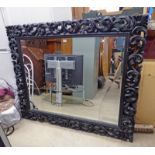 MIRROR WITH DECORATIVE FRAME GLASS AS SEEN OVERALL SIZE 127 X 151 CM