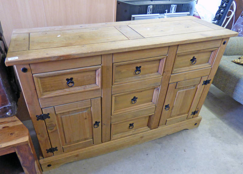 PINE SIDEBOARD WITH 3 CENTRALLY SET DRAWERS, FLANKED BY DRAWER OVER PANEL DOOR TO EITHER SIDE.
