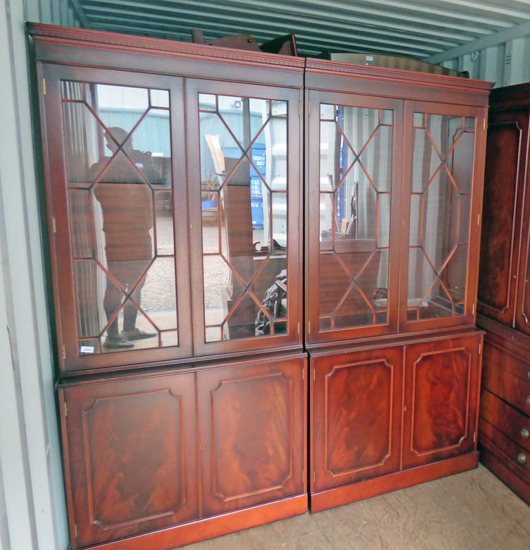 MAHOGANY CABINET WITH 3 SECTION OF PANEL DOORS OVER 4 PANEL DOORS & DRAWERS ON PLINTH BASE WIDTH