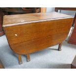 OAK DROP LEAF TABLE ON SHAPED SUPPORTS
