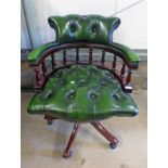 GREEN LEATHER COVERED MAHOGANY SWIVEL CHAIR