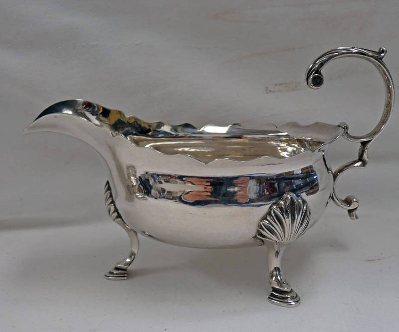 GEORGE II SILVER SAUCE BOAT WITH SHAPED HANDLE ON PAD FEET,