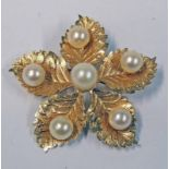EASTERN YELLOW METAL LEAF BROOCH SET WITH 6 CULTURED PEARLS - 8.