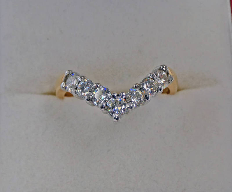 18CT GOLD 7-STONE DIAMOND SET WISHBONE RING Condition Report: Ring size: N.