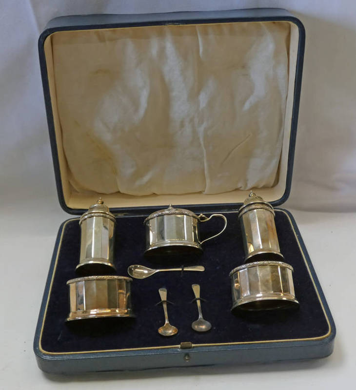 CASED SILVER 5-PIECE CONDIMENT SET WITH BLUE GLASS LINERS,