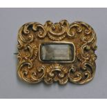 19TH CENTURY GOLD SCROLL WORK PANEL BROOCH INSET WITH GLAZED PANEL - 3CM WIDE, 6.