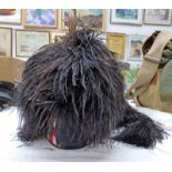 PIPERS FEATHERED BONNET WITH TAILS AND A RED AND WHITE CHEQUERED BAND