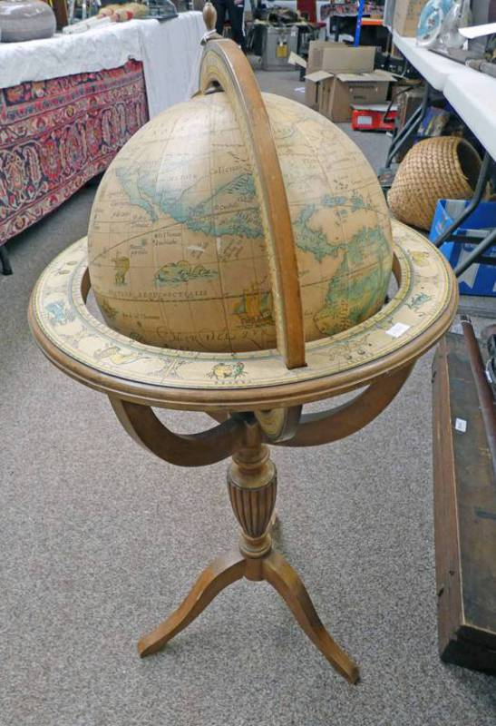 CARVED WOODEN GLOBE ON STAND