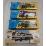 FOUR CORGI MODEL BUSES INCLUDING 53901 - UNION PACIFIC YELLOW COACH 743, 54004 - NEW YORK GM 4507,