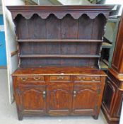 18TH CENTURY OAK WELSH DRESSER WITH PLATE RACK BACK OVER BASE OF 3 DRAWERS OVER 2 PANEL DOORS ON