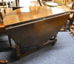 19TH CENTURY OAK DROP LEAF TABLE ON BARLEY TWIST SUPPORTS
