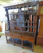 18TH CENTURY OAK WELSH DRESSER WITH PLATE RACK BACK OVER BASE OF 3 DRAWERS ON TURNED SUPPORTS,