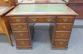 EARLY 20TH CENTURY OAK KNEEHOLE DESK WITH LEATHER INSERT AND 3 FRIEZE DRAWERS OVER 6 DRAWERS,