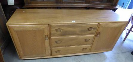ERCOL BEECH BLONDE SIDEBOARD WITH 3 CENTRAL DRAWERS FLANKED BY PANEL DOOR EACH SIDE,