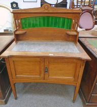 LATE 19TH CENTURY OAK WASHSTAND WITH GALLERY TOP WITH TILE INSERT OVER BASE OF 2 PANEL DOORS WITH