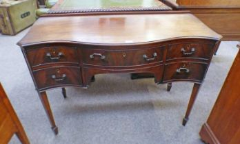 LATE 19TH CENTURY MAHOGANY KNEEHOLE DESK WITH SERPENTINE FRONT AND FRIEZE DRAWER FLANKED BY 2
