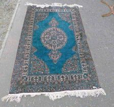 EASTERN RUG WITH BLUE DECORATION,