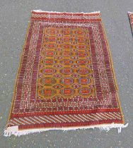EASTERN RUG WITH MAROON & GOLD DECORATION,