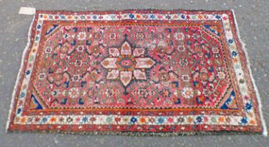 RED EASTERN RUG - 125 X 74 CMS