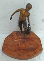 EARLY 20TH CENTURY METAL FIGURE OF A BOY CARRYING A PAIL OF WATER ON A HARDSTONE BASE,