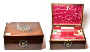 A Victorian walnut work box inlaid with mother-of-pearl