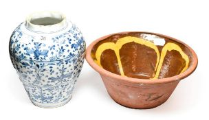 An 18th century Delft vase and a slipware bowl, possibly 19th century (2) . Delft vase free from