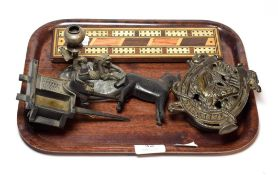 A primitive carved wood horse and cart, a cast iron money box, a cribbage board, a candlestick
