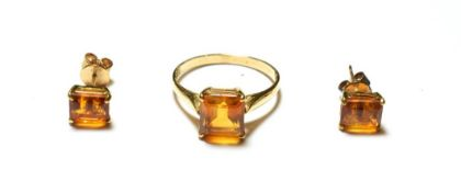 A citrine ring, stamped '9K', finger size Q1/2; and a pair of matching earrings, unmarked . The