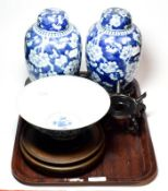 A pair of Chinese blue and white ginger jars and covers decorated in underglaze blue with prunus