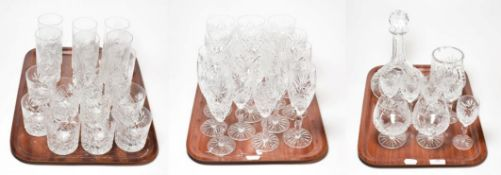 A selection of cut glass comprising wines, champagnes, cordial, tumblers, sherry, brandy, jug and