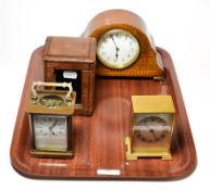 A brass carriage timepiece with fitted travelling case, inlaid mantel timepiece and a brass desk