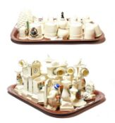 Crested china to include thimbles, cheese dishes, sundials, stick telephones, longcase clocks etc (