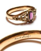 A Victorian gilt metal purple glass hinged bangle, inner measurements 6.3cm by 5.3cm . Gross