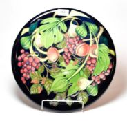 A Moorcroft Queen's Choice pattern charger, designed by Emma Bossons, 35.5cm diameter.. Second