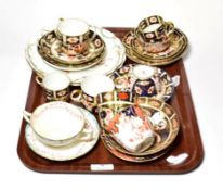 A group of Royal Crown Derby Imari and other tea wares. One 1128 saucer with a small chip. Chocolate