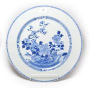 A 19th century Chinese export blue and white charger (a.f.). Cracked right through and repaired.,