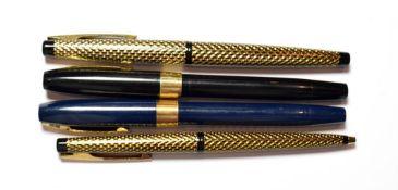 Three Sheaffer fountain pens and a ballpoint pen