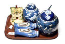 Two Chinese ginger jars and covers, a Chinese blue and white boat, a Staffordshire pastille