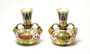 A pair of Royal Crown Derby Imari pattern twin handled vases (2). No damage or repair. Some light