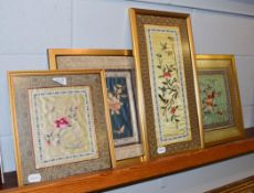 Four Oriental embroidered silk panels (framed)